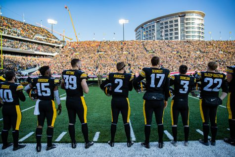 Iowa players stand for the national anthem during a football game between Iowa and Minnesota at Kinnick Stadium on Saturday, Nov. 16, 2019.