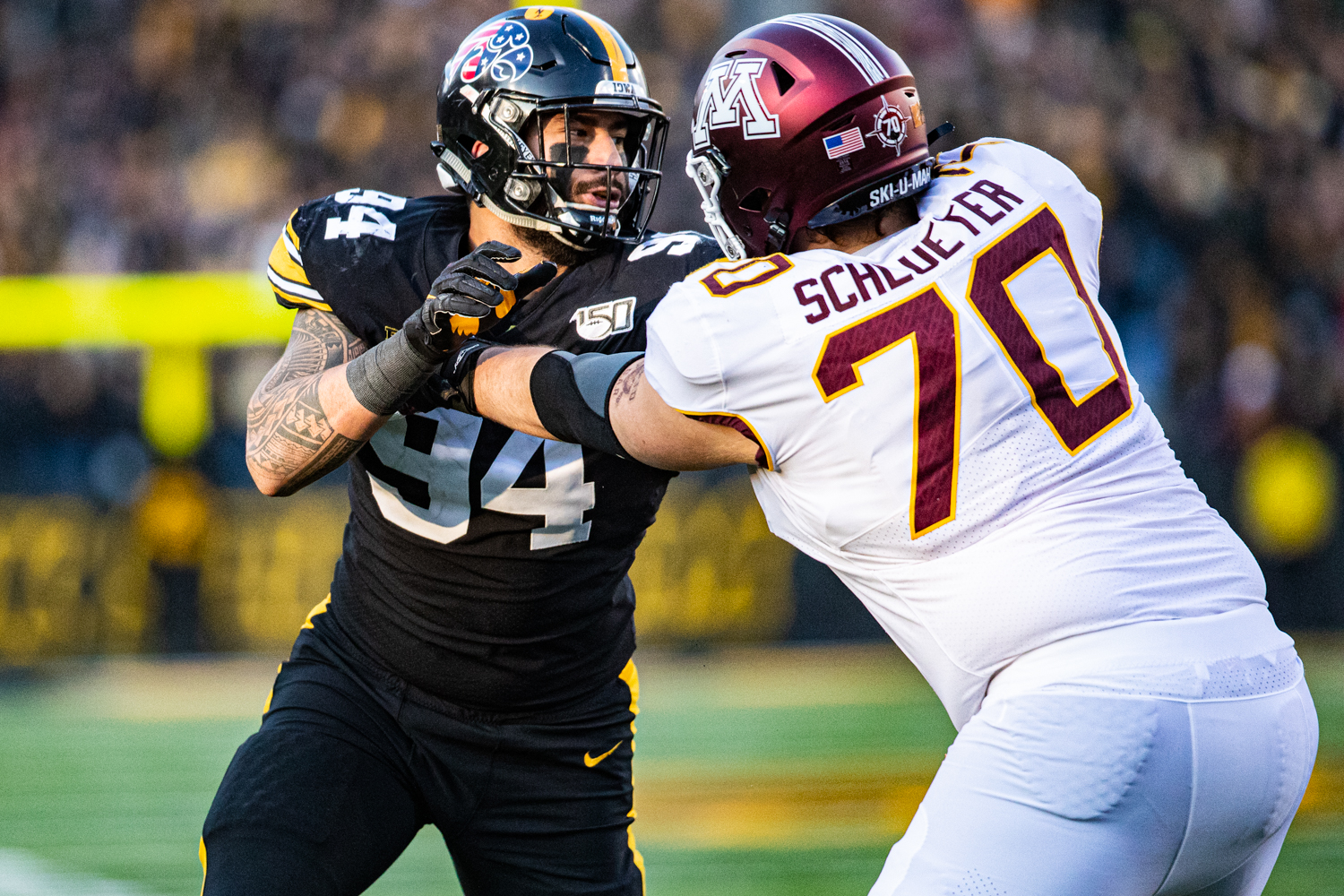 Iowa defensive end AJ Epenesa rushes the passer during a football game between Iowa and Minnesota at Kinnick Stadium on Saturday, Nov. 16, 2019. Epenesa finished with 2.5 sacks on the day.