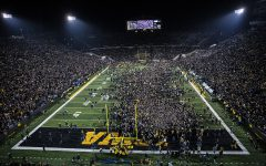 Fans storm the field during a football game between Iowa and Minnesota at Kinnick Stadium on Saturday, Nov. 16, 2019. The Hawkeyes defeated the Gophers, 23-19, ending Minnesota's undefeated season.