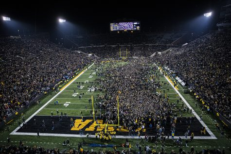 Fans storm the field during a football game between Iowa and Minnesota at Kinnick Stadium on Saturday, Nov. 16, 2019. The Hawkeyes defeated the Gophers, 23-19, ending Minnesota