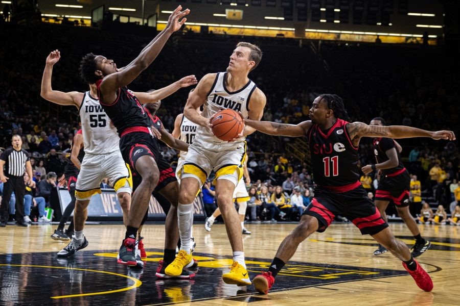 Iowa+forward+Jack+Nunge+handles+the+ball+during+a+men%27s+basketball+game+between+Iowa+and+Southern+Illinois-Edwardsville+at+Carver-Hawkeye+Arena+on+Friday%2C+Nov.+8%2C+2019.+Nunge+scored+2+points+and+had+2+assists+in+the+win.