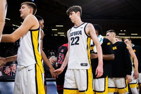 Iowa forward Patrick McCaffery shakes hands after a men