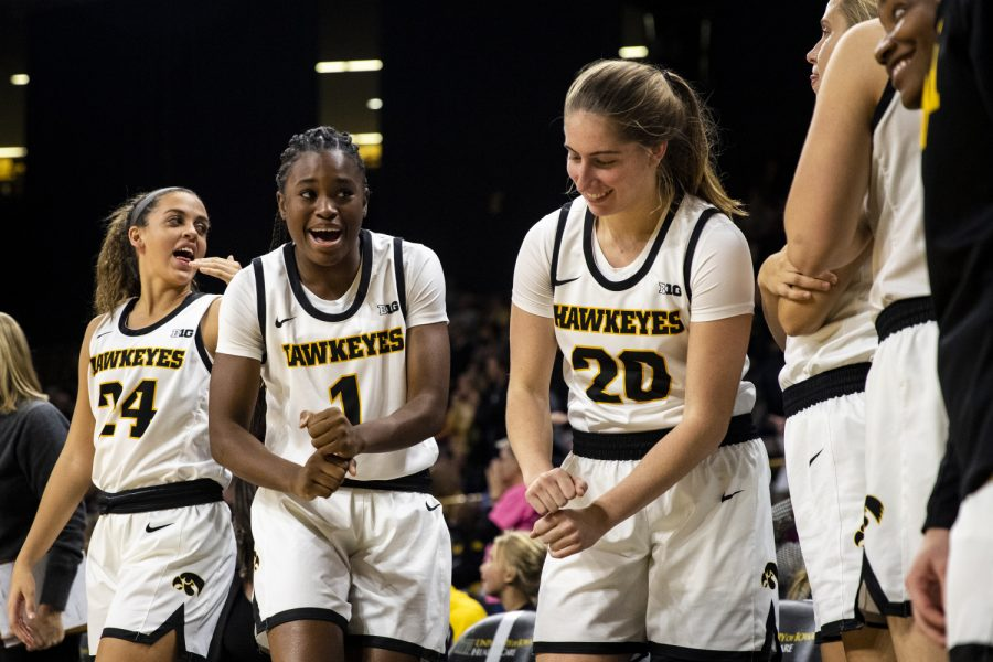 Iowa players Gabbie Marshall, Tomi Taiwo, and Kate Martin celebrate as the Hawkeyes win during a womenÕs basketball game between Iowa and Princeton at Carver-Hawkeye Arena on Wednesday, November 20, 2019.