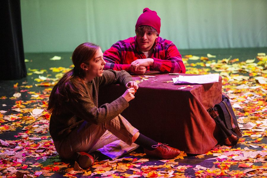 Acting as the characters of October and Nevada, Olivia Schneider and Sterling Isler discuss writing as a form of therapy during a dress rehearsal for Fall's Eve on December 4th. Fall's Eve, written by Brett Stone and directed by Aimee Townsend, opens on Dec. 6, 2019. (Nichole Harris/The Daily Iowan)