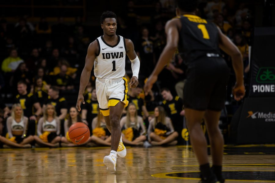 Iowa guard Joe Toussaint keeps the ball away from Kennesaw States Terrell Burden during a basketball game against Kennesaw State University on Sunday, Dec. 29, 2019 at Carver Hawkeye Arena. The Hawkeyes defeated the Owls, 93-51. (Emily Wangen/The Daily Iowan)