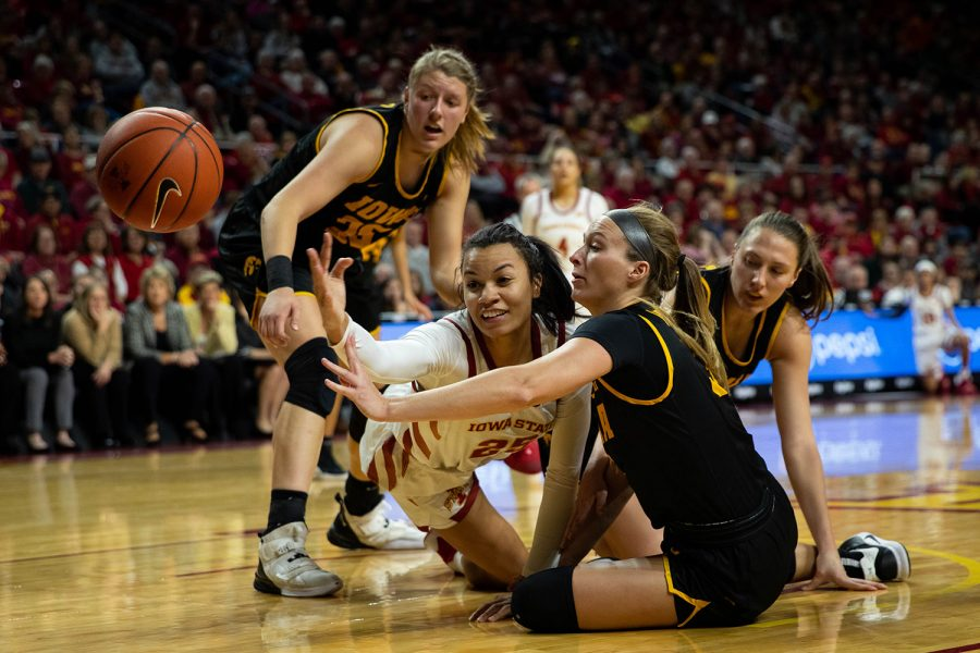Players fight for the ball during a game against Iowa State at the Hilton Coliseum on Wednesday December 11, 2019. The Hawkeyes defeated the Cyclones, 75-69. The Hawkeyes had 13 turnovers.