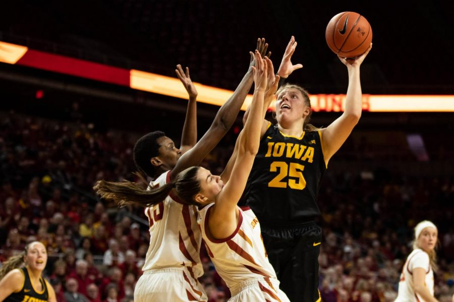 Iowa center Monika Czinano attempts a shot under the basket in Iowa's 75-69 victory over Iowa State Wednesday night.
