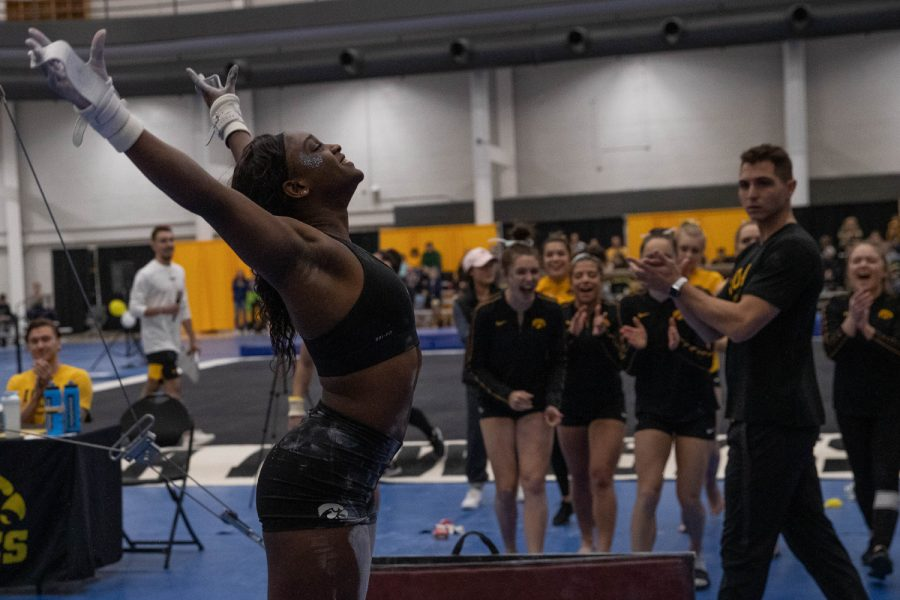 Iowa gymnast Jerquavia Henderson lands after dismounting from the uneven bars during an inter-squad gymnastics meet on Saturday, Dec. 7, 2019 at the Field House. The gold team defeated the black team 7-6. (Emily Wangen/The Daily Iowan)