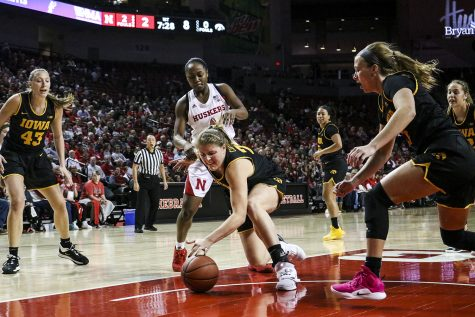 Iowa center Monika Czinano goes to steal the ball from a Husker player during a womenÕs basketball game between Iowa and Nebraska at Pinnacle Bank Arena in Lincoln, Nebraska on Saturday, December 28. The Hawkeyes fell to the Huskers 78-69. (Nichole Harris/The Daily Iowan)