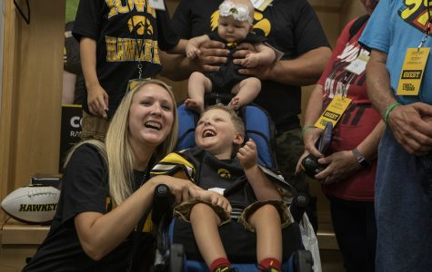 A heart for the Hawks: Kid Captain leads the way to the Holiday bowl