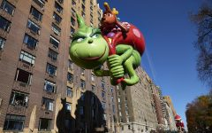 The Grinch balloon floats down Central Park West during the 91st Annual Macy's Thanksgiving Day Parade on Thursday, Nov. 23, 2017 in Manhattan, N.Y.  (James Keivom/New York Daily News/TNS)