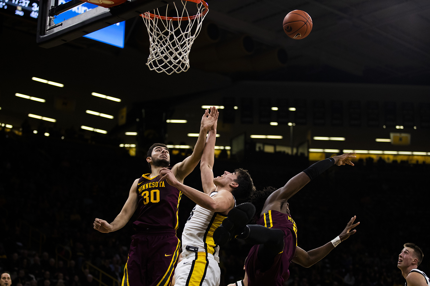 Iowa center Luka Garza jumps for the ball during the men's basketball game against Minnesota at Carver-Hawkeye Arena on Monday, December 9, 2019. The Hawkeyes defeated the Gophers 72-52.
