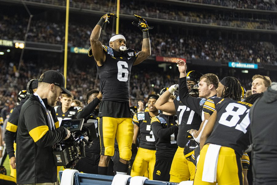 Iowa wideout Ihmir Smith-Marsette celebrates his kick-return touchdown during the 2019 SDCCU Holiday Bowl between Iowa and USC in San Diego on Friday, Dec. 27, 2019.