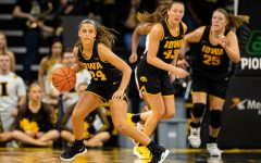 Iowa guard Gabbie Marshall dribbles during a women's basketball match between Iowa and Clemson at Carver-Hawkeye Arena on Wednesday, Dec. 4, 2019. The Hawkeyes defeated the Tigers, 74-60.