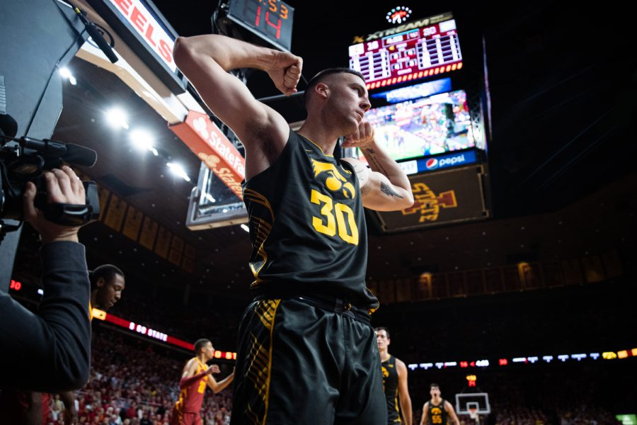Iowa guard Connor McCaffery celebrates a basket during a men's basketball match between Iowa and Iowa State at Hilton Coliseum on Thursday, Dec. 12, 2019. The Hawkeyes defeated the Cyclones, 84-68. (Shivansh Ahuja/The Daily Iowan)
