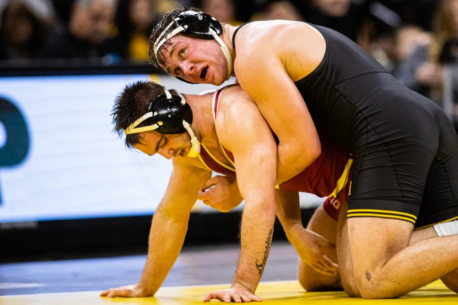 Iowa%E2%80%99s+194-pound+Jacob+Warner+wrestles+Wisconsin%E2%80%99s+Taylor+Watkins+during+a+wrestling+match+between+No.1+Iowa+and+No.+6+Wisconsin+at+Carver-Hawkeye+Arena+on+Sunday%2C+Dec.+1%2C+2019.+Warner+won+by+decision%2C+5-2%2C+and+the+Hawkeyes+defeated+the+Badgers%2C+32-3.+