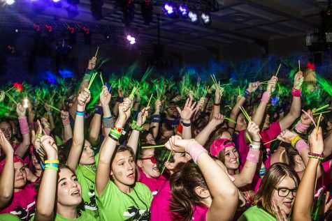 Dancers wave their glow sticks during Power Hour at Dance Marathon 25 at the IMU on Saturday, Feb. 2, 2019.