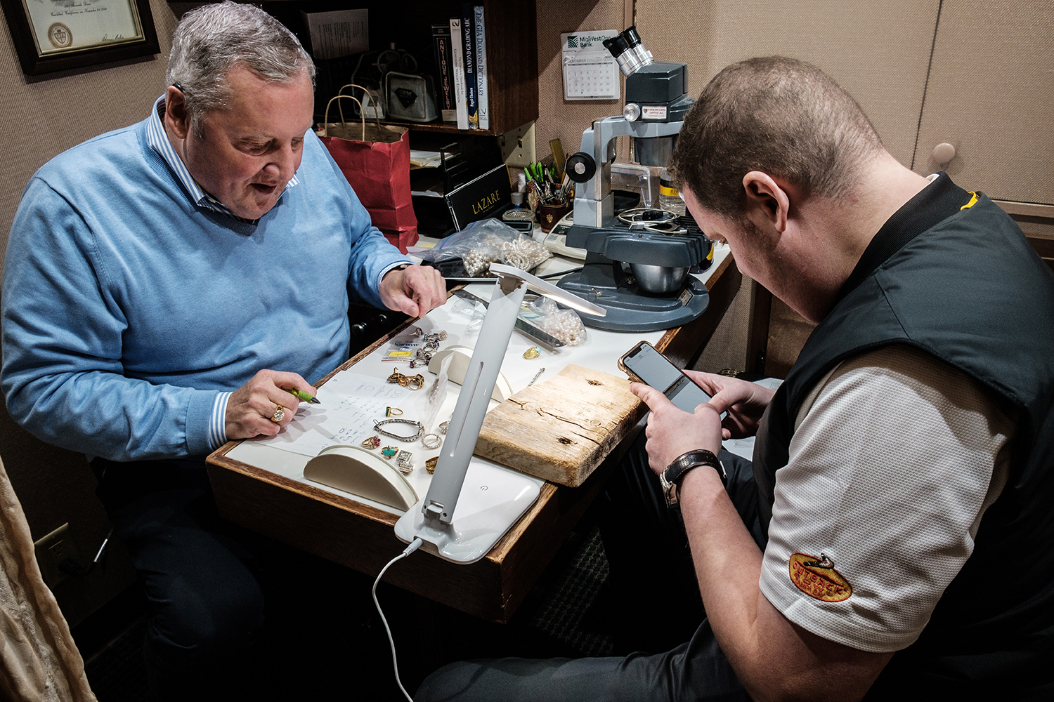 Bill Nusser Jr. and Charlie Nusser test the quality of a jewelery collection at Hands Jewlers in Iowa City on November 15, 2019. Hands Jewlers has been family-owned and located in Iowa City since 1895.