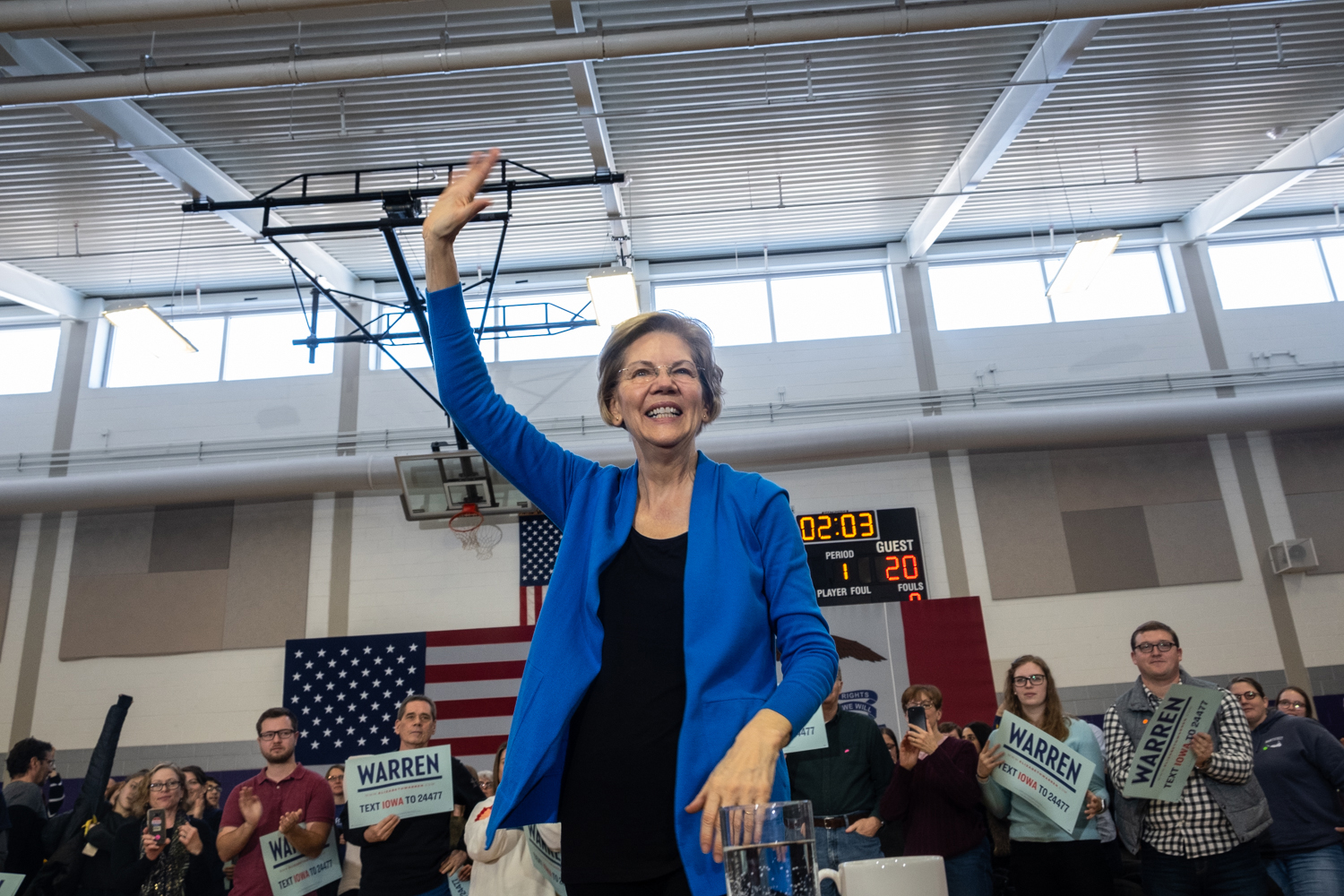 Senator Elizabeth Warren, D-Mass. waves to the audience following a town hall event at North Central Junior High School in North Liberty on Saturday, December 21, 2019. (Wyatt Dlouhy/The Daily Iowan)