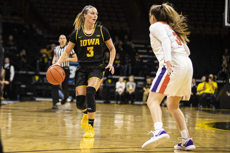 Iowa+guard+Makenzie+Meyer+looks+to+pass+during+a+women%C3%95s+basketball+match+between+Iowa+and+Clemson+at+Carver-Hawkeye+Arena+on+Wednesday%2C+Dec.+4%2C+2019.+The+Hawkeyes+defeated+the+Tigers%2C+74-60.+%28Shivansh+Ahuja%2FThe+Daily+Iowan%29
