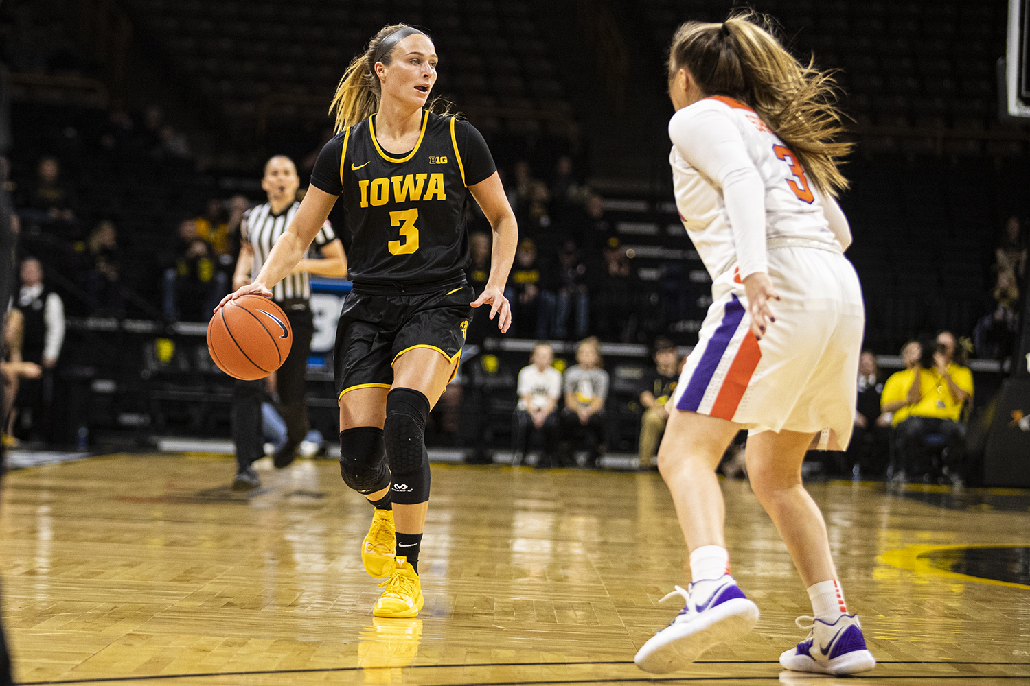 Iowa guard Makenzie Meyer looks to pass during a womenÕs basketball match between Iowa and Clemson at Carver-Hawkeye Arena on Wednesday, Dec. 4, 2019. The Hawkeyes defeated the Tigers, 74-60. (Shivansh Ahuja/The Daily Iowan)