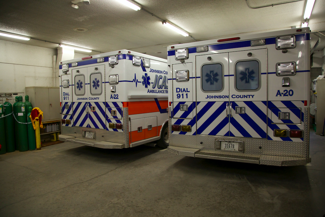 Johnson County ambulances are photographed Thursday, Feb 4 in Iowa City.  Four ambulances are parked tightly in one garage with limited space.  (Eden Hall/The Daily Iowan)