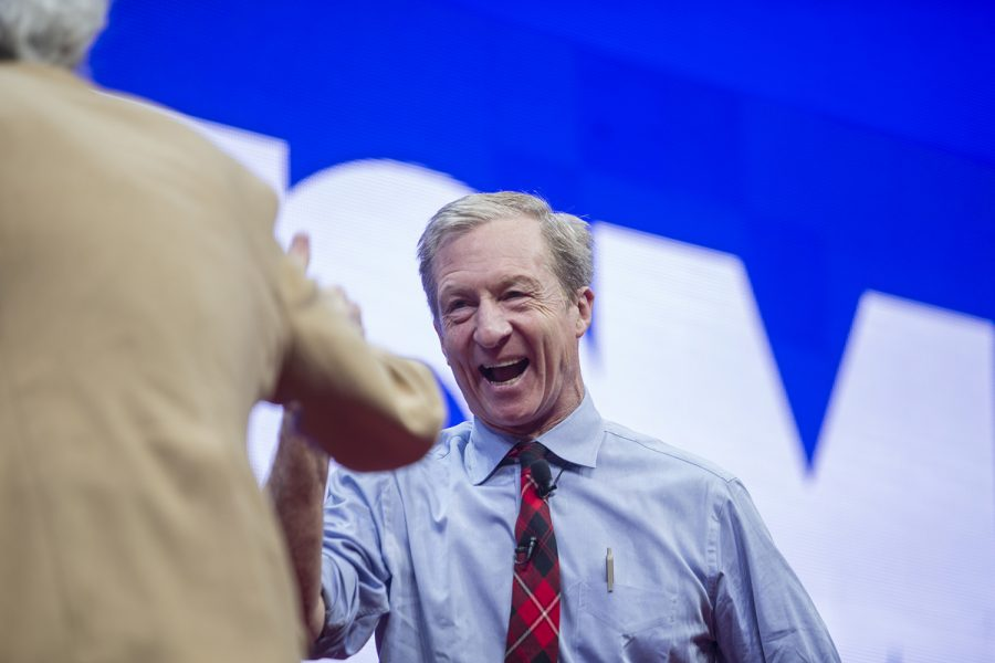 Democratic candidate Tom Steyer laughs with moderator Art Cullen during the Teamsters Presidential Candidate Forum in the Veterans Memorial Coliseum in Cedar Rapids on Saturday, Dec. 7, 2019.
