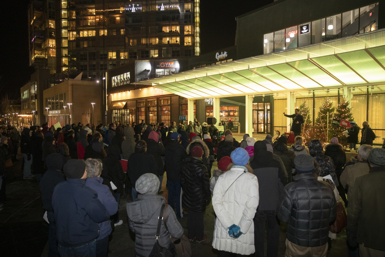 Attendees are seen gathering together during the Impeachment Rally on Tuesday, Dec. 17, 2019 at the Ped Mall in downtown Iowa City. Multiple speakers from the Iowa City area shared their opinions on President Trump's impeachment process. (Hannah Kinson/The Daily Iowan)