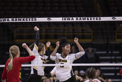 Iowa middle blockers Amiya Jones and Blythe Rients celebrate a point during a volleyball match between the University of Iowa and University of Maryland at Carver Hawkeye Arena on Saturday, November 30, 2019.  The Hawkeyes defeated the Terrapins 3-1.