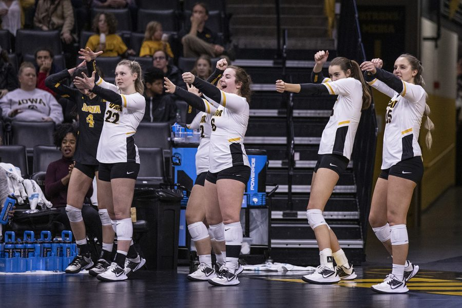 Iowa players celebrate a point during a volleyball match between the University of Iowa and University of Maryland at Carver Hawkeye Arena on Saturday, November 30, 2019.  The Hawkeyes defeated the Terrapins 3-1.
