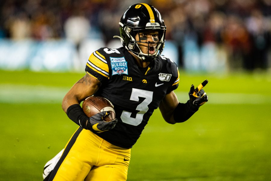 Iowa+wideout+Tyrone+Tracy%2C+Jr.+carries+the+ball+during+the+2019+SDCCU+Holiday+Bowl+between+Iowa+and+USC+in+San+Diego+on+Friday%2C+Dec.+27%2C+2019.+Tracy%2C+Jr.+scored+first+in+the+game+with+this+23-yard+carry.