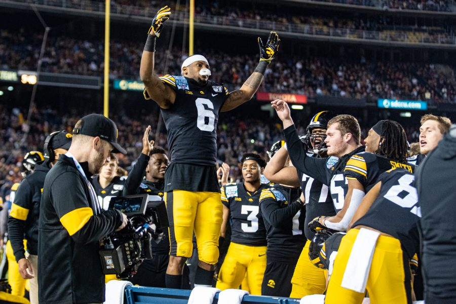 Iowa wideout Ihmir Smith-Marsette celebrates a kick-return touchdown during the 2019 SDCCU Holiday Bowl between Iowa and USC in San Diego on Friday, Dec. 27, 2019. Smith-Marsette scored rushing, receiving, and return touchdowns in the game.