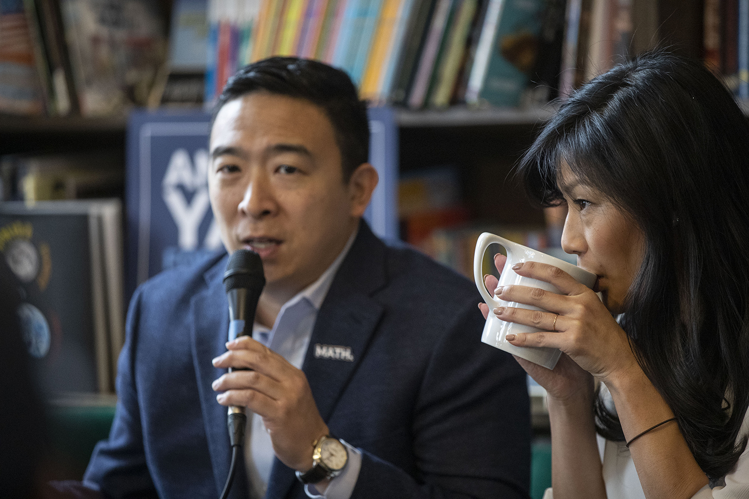 Democratic candidate Andrew Yang speaks as his wife Evelyn Yang takes a drink during a roundtable on the topic of family and autism at Sidekick cafe in University Heights on Saturday, Dec. 14, 2019. The Yang's shared their experience with their son Christopher, who is on the autism spectrum.