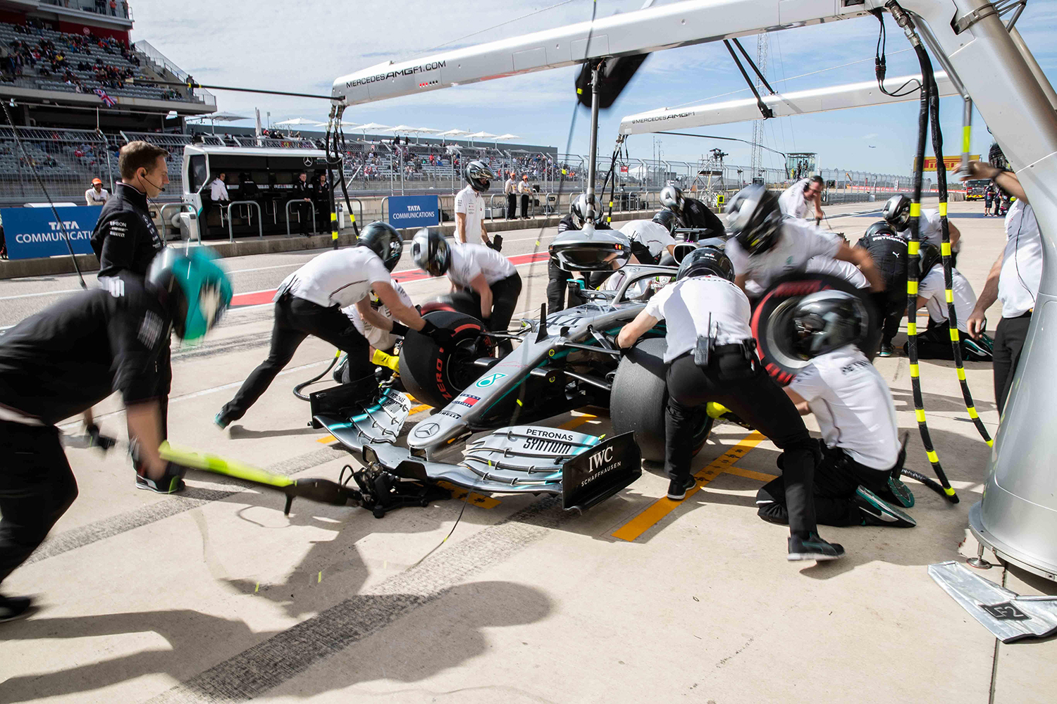 Lewis Hamilton's crew works on his car at a pit stop during the third practice session for the United States Grand Prix at the Circuit of the Americas on Saturday, Nov. 2, 2019.  [LOLA GOMEZ / AMERICAN-STATESMAN]