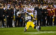 Iowa defensive back Jack Koerner tackles USC tailback Vavae Malepeai during the Holiday Bowl game between Iowa and USC at SDCCU Stadium on Friday, Dec. 27, 2019. The Hawkeyes defeated the Trojans, 49-24.