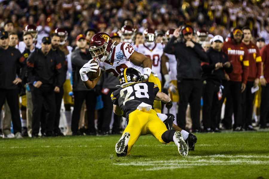 Iowa+defensive+back+Jack+Koerner+tackles+USC+tailback+Vavae+Malepeai+during+the+Holiday+Bowl+game+between+Iowa+and+USC+at+SDCCU+Stadium+on+Friday%2C+Dec.+27%2C+2019.+The+Hawkeyes+defeated+the+Trojans%2C+49-24.