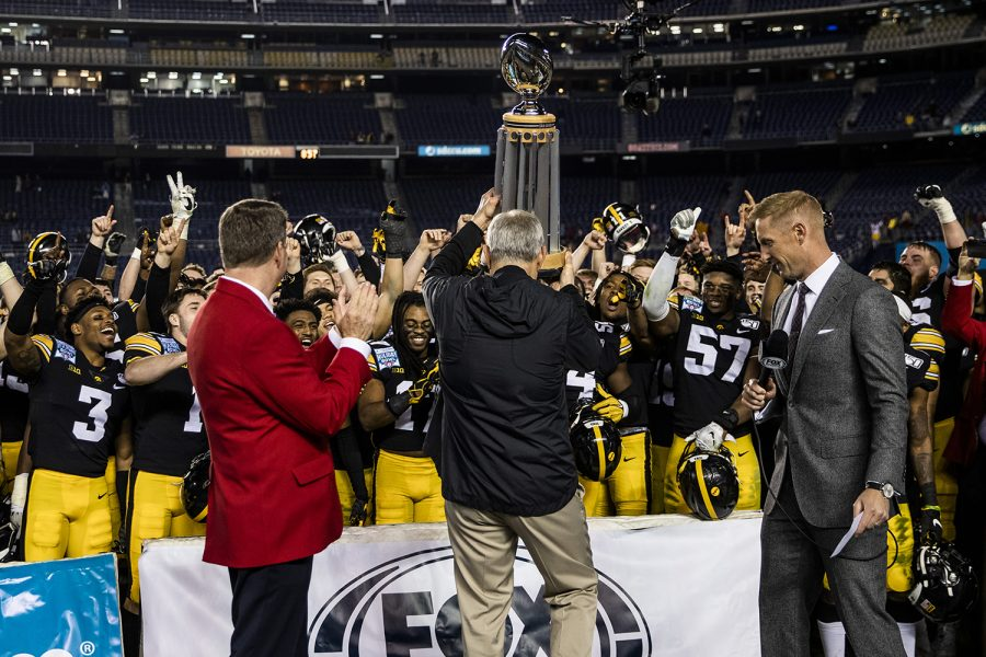 Iowa+head+coach+Kirk+Ferentz+presents+the+trophy+after+the+Holiday+Bowl+game+between+Iowa+and+USC+at+SDCCU+Stadium+on+Friday%2C+Dec.+27%2C+2019.+The+Hawkeyes+defeated+the+Trojans%2C+49-24.