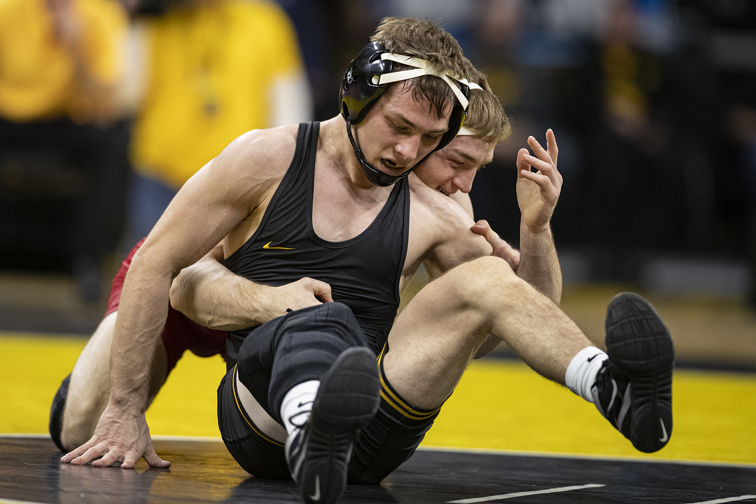 Iowa's 125-pound Spencer Lee wrestles Wisconsin's Michael Cullen during a wrestling match between No.1 Iowa and No. 6 Wisconsin at Carver-Hawkeye Arena on Sunday, Dec. 1, 2019. Lee won by technical fall in 3:13.