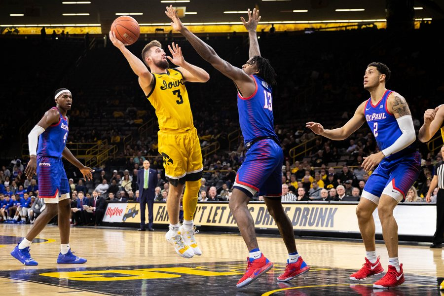 Iowa guard Jordan Bohannon shoots during a game against Depaul at Carver Hawkeye Arena on Monday, November 11, 2019. The Hawkeyes were defeated by the Blue Demons 93-78.