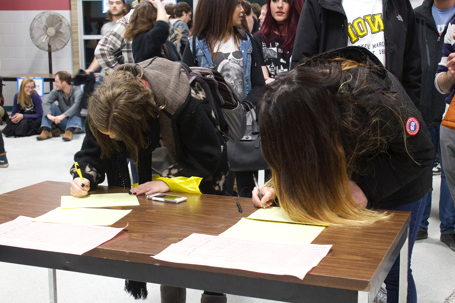 Students and members of the community sign in to caucus for the Democrat Party in the Robert Lee Rec Center on February 1, 2016.