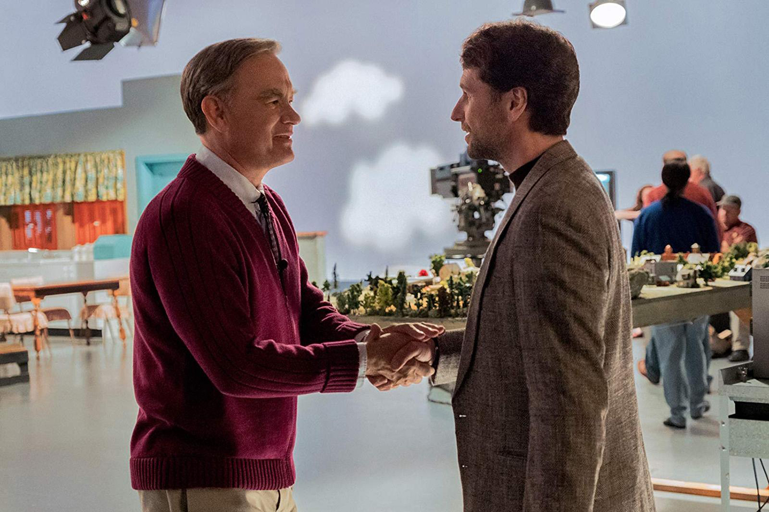 """Reassuring television host Fred Rogers (Tom Hanks) meets skeptical journalist Lloyd Vogel (Matthew Rhys) in director Marielle Heller's unconventional biopic, """"A Beautiful Day in the Neighborhood."""" [Lacey Terrell/Sony Pictures/TNS]"""