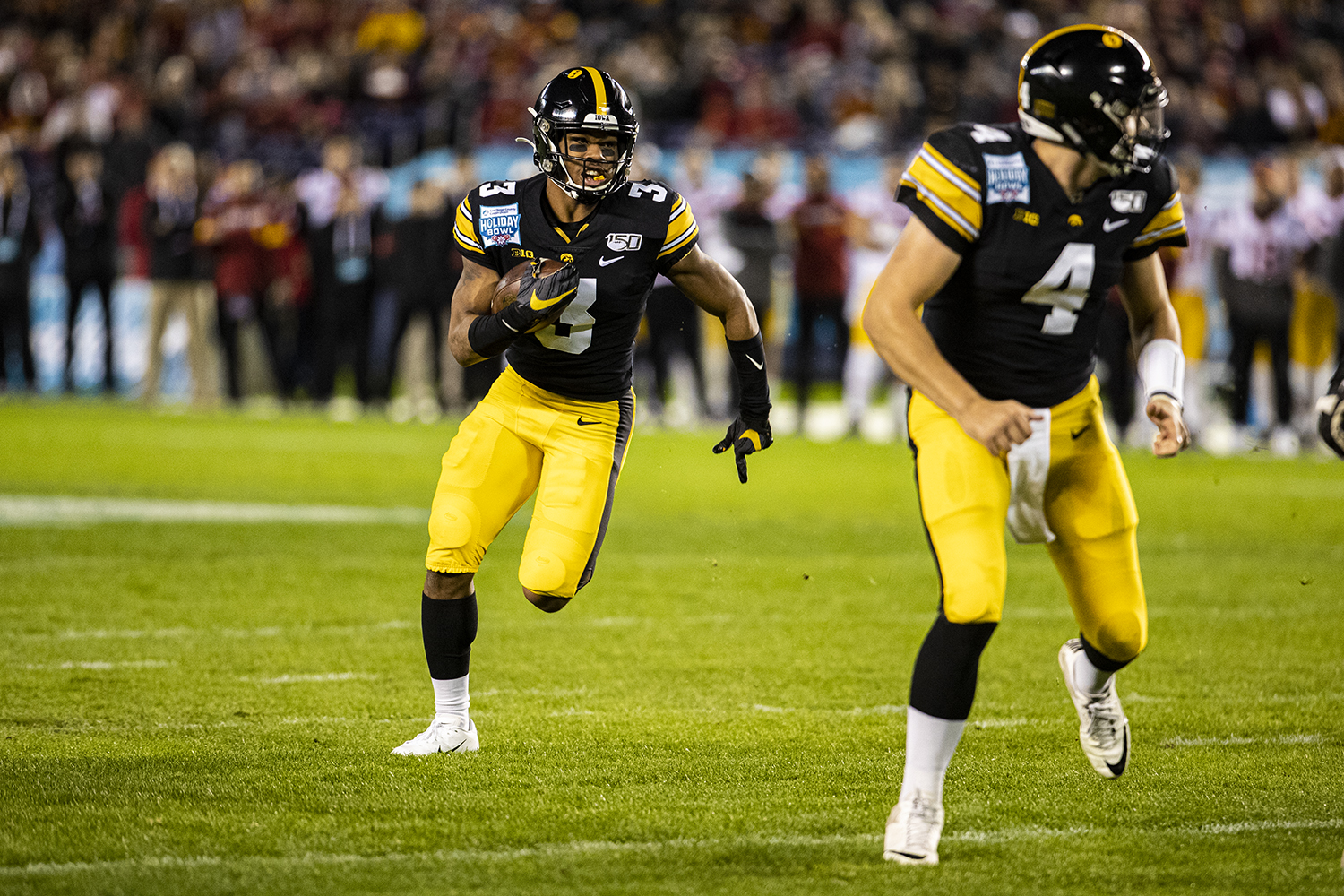 Iowa wideout Tyrone Tracy, Jr. carries the ball during the 2019 SDCCU Holiday Bowl between Iowa and USC in San Diego on Friday, Dec. 27, 2019.