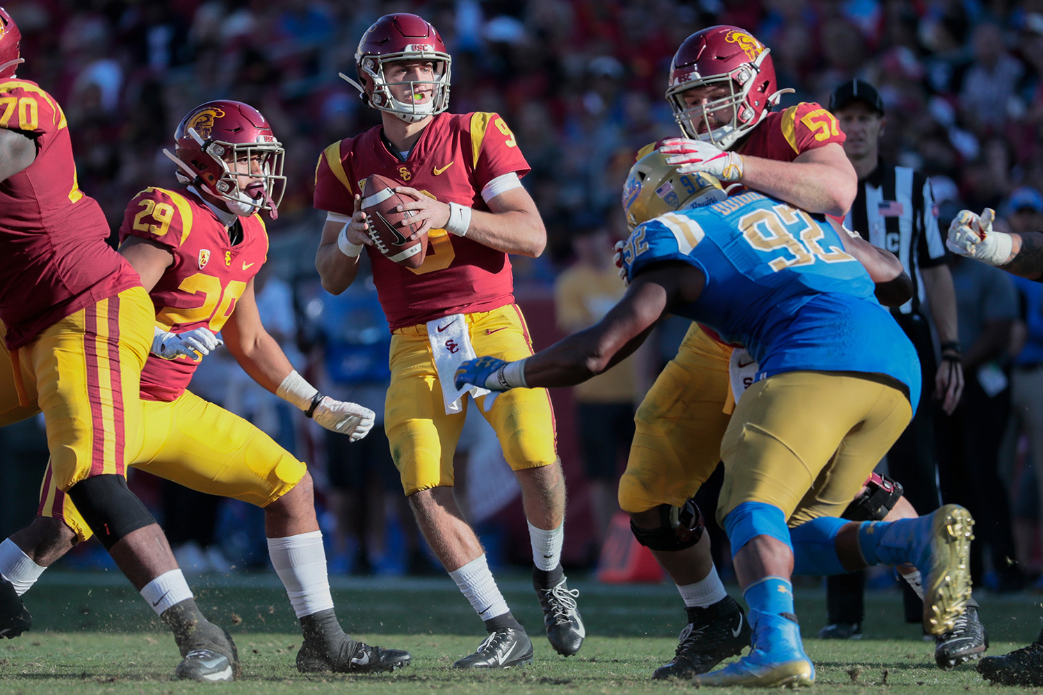 USC quarterback Kedon Slovis (9) drops back to pass against UCLA during the third quarter at the Los Angeles Memorial Coliseum on Saturday, Nov. 23, 2019, in Los Angeles. USC won, 52-35. (Robert Gauthier/Los Angeles Times/TNS)