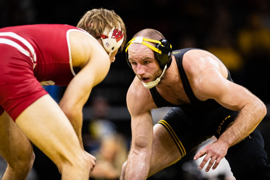 Iowa%E2%80%99s+165-pound+Alex+Marinelli+wrestles+Wisconsin%E2%80%99s+Evan+Wick+during+a+wrestling+match+between+No.1+Iowa+and+No.+6+Wisconsin+at+Carver-Hawkeye+Arena+on+Sunday%2C+Dec.+1%2C+2019.+Marinelli+won+by+decision%2C+4-2%2C+and+the+Hawkeyes+defeated+the+Badgers%2C+32-3.+