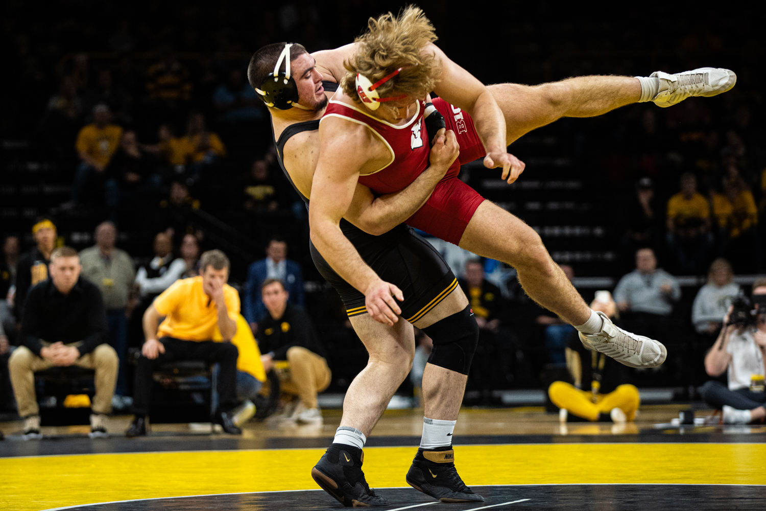 Iowa's 285-pound Tony Cassioppi wrestles Wisconsin's Trent Hillger during a wrestling match between No.1 Iowa and No. 6 Wisconsin at Carver-Hawkeye Arena on Sunday, Dec. 1, 2019. Cassioppi won by decision, 3-2, and the Hawkeyes defeated the Badgers, 32-3. (Shivansh Ahuja/The Daily Iowan)