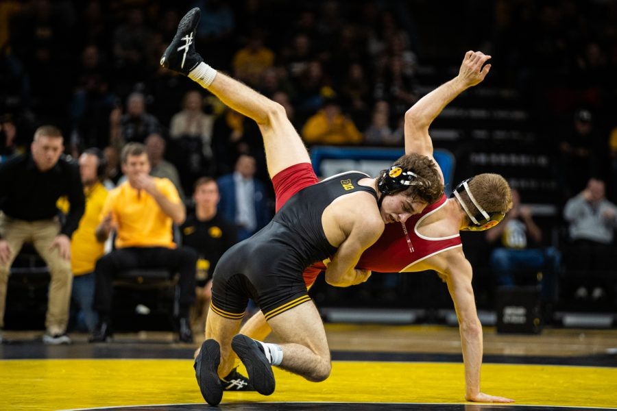 Iowa%E2%80%99s+133-pound+Austin+DeSanto+wrestles+Wisconsin%E2%80%99s+Seth+Gross+during+a+wrestling+match+between+No.1+Iowa+and+No.+6+Wisconsin+at+Carver-Hawkeye+Arena+on+Sunday%2C+Dec.+1%2C+2019.+DeSanto+won+by+decision%2C+6-2%2C+and+the+Hawkeyes+defeated+the+Badgers%2C+32-3.+
