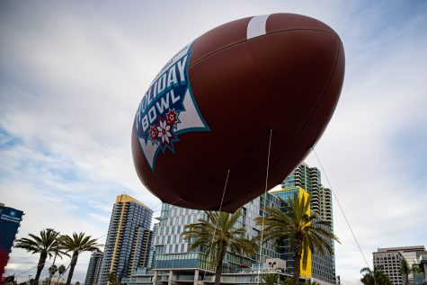 The Holiday Boal float flies down Harbor St. during the 2019 Holiday Bowl Parade in San Diego on Thursday, Dec. 26, 2019.