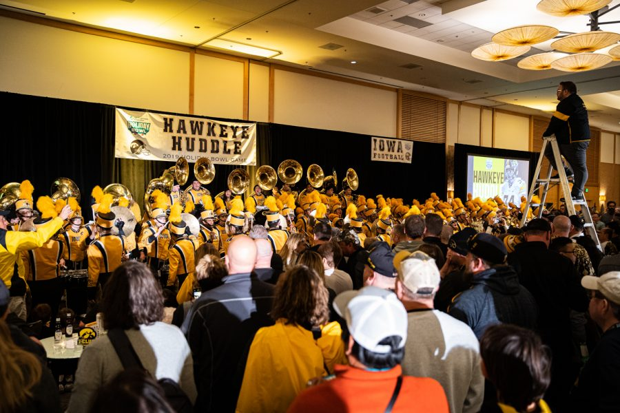 The Hawkeye Marching Band performs during the Hawkeye Huddle at the Hilton San Diego Bay Front on Thursday, Dec. 26, 2019.
