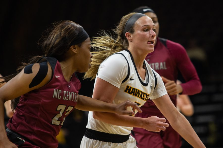Iowa guard Makenzie Meyer fights for control of the ball during a game against North Carolina Central University on Saturday, Dec. 14, 2019 at Carver Hawkeye Arena. The Hawkeyes defeated the Eagles, 102-50 (Emily Wangen/The Daily Iowan)
