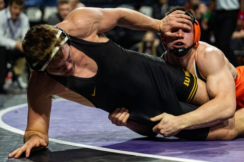 Iowa's 197-pound Jacob Warner wrestles Princeton's Pat Brucki during the fourth session of the 57th Annual Ken Kraft Midlands Championships at the Sears Centre in Hoffman Estates, IL, on Monday, Dec. 30, 2019. Brucki won by decision, and placed third in the weight class.